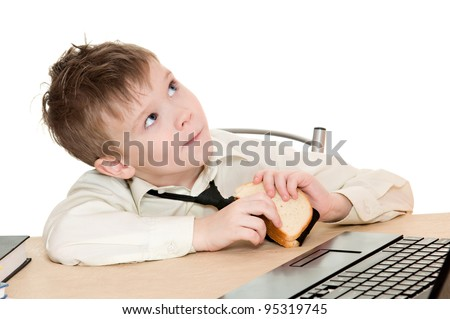 thoughtful boy eating a sandwich with his tie isolated on white background