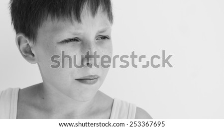 Thoughtful boy with serious expression. Closeup headshot. - stock photo