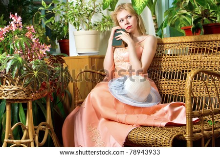 thoughtful bride with bible in garden. Young bride in garden bride collection - stock photo