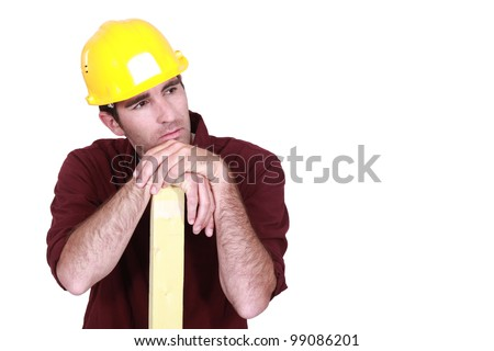 Thoughtful builder - stock photo