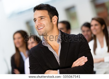 Thoughtful business man leading a corporate group - stock photo