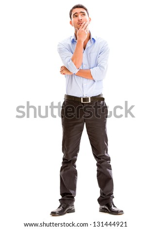 Thoughtful business man looking up - isolated over a white background - stock photo