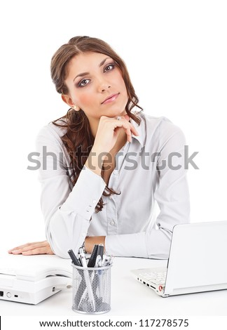 Thoughtful business woman in the office - stock photo