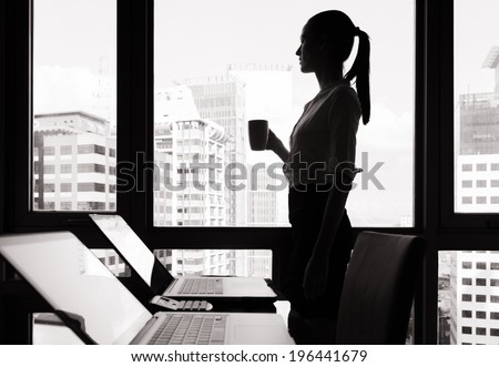 Thoughtful business woman in the office. - stock photo