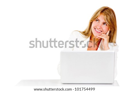 Thoughtful business woman with a laptop computer - isolated over white - stock photo