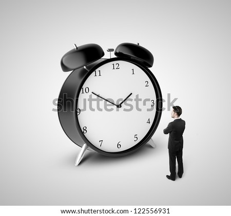 thoughtful businessman and alarm clock