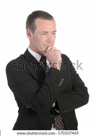 thoughtful  businessman in front of white background - stock photo