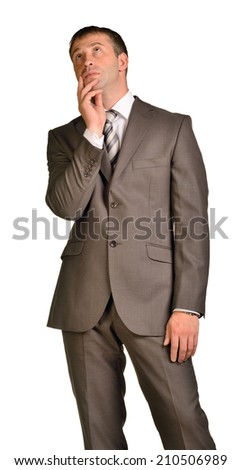 Thoughtful businessman looking up - stock photo
