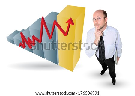 Thoughtful businessman next to a graph - stock photo