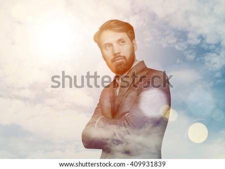 Thoughtful businessman on sky background - stock photo