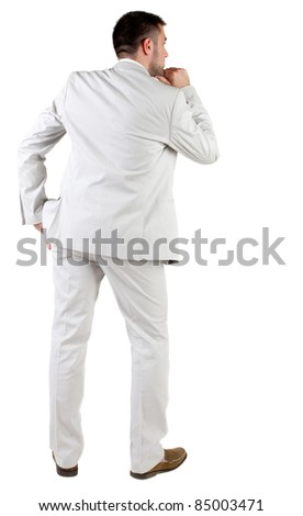 thoughtful businessman. Rear view. isolated over white.