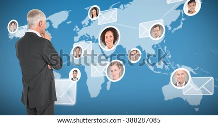 Thoughtful businessman standing back to camera against map with emails