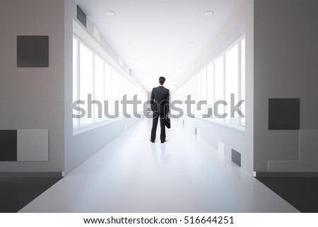 Thoughtful businessman standing in modern interior with city view. 3D Rendering