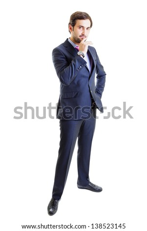 Thoughtful businessman with hand on hip isolated on white - stock photo