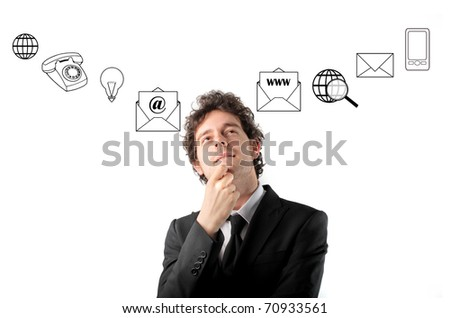 Thoughtful businessman with icons on the background - stock photo