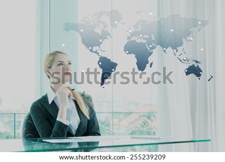 Thoughtful businesswoman in office, business globalization concept - stock photo