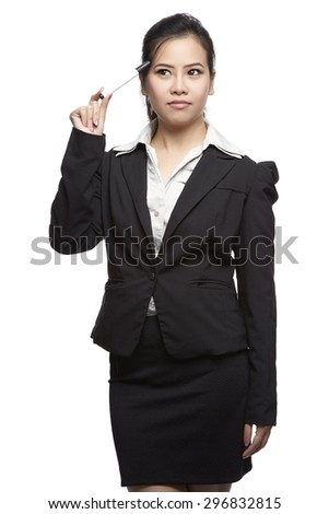 Thoughtful businesswoman looking up - isolated over a white background. (clipping path included) - stock photo