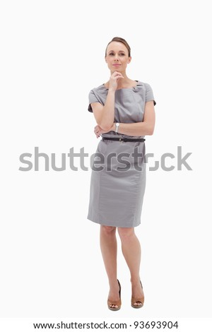 Thoughtful businesswoman posing against white background - stock photo
