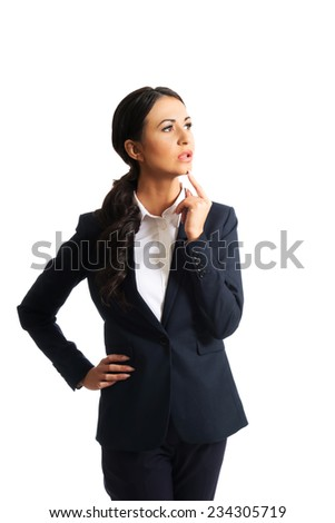 Thoughtful businesswoman with a finger under chin. - stock photo