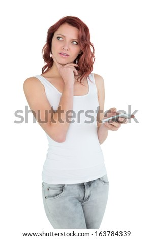 Thoughtful casual young woman with mobile phone over white background