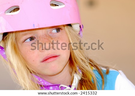 Thoughtful child in a safety helmet - stock photo
