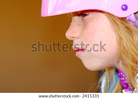 Thoughtful child with a safety helmet - stock photo