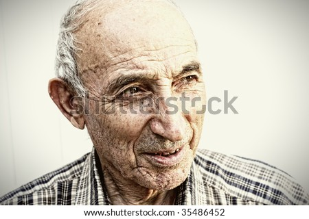 Thoughtful elderly man looking aside closeup portrait - stock photo