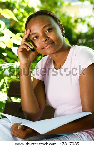 thoughtful female college student outdoors - stock photo