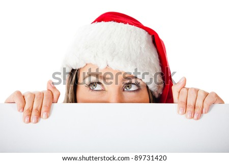 Thoughtful female Santa holding a banner  ? isolated over a white background