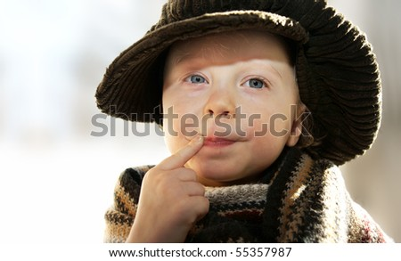thoughtful funny child, space for text - stock photo