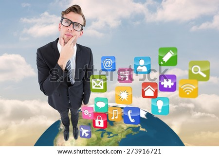 Thoughtful geeky hipster businessman looking up against beautiful blue sky with clouds - stock photo