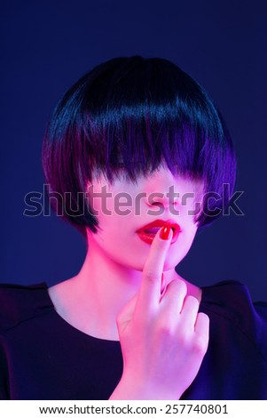 thoughtful girl in a black wig - stock photo