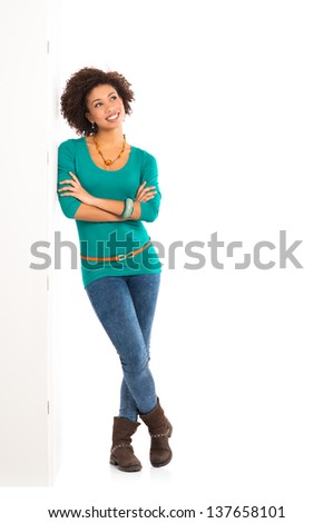 Thoughtful Girl Isolated Leaning On Wall Over White Background - stock photo