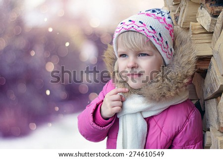 Thoughtful girl looks winter, background, bokeh, wood, cold - stock photo