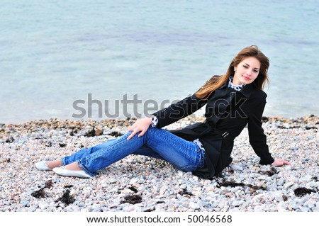 thoughtful girl relaxing on the beach in spring time