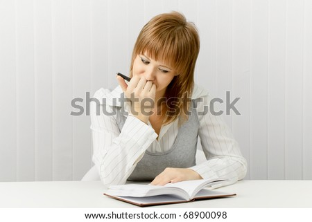 thoughtful girl with a notebook. Secretary in the office. - stock photo