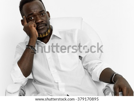 Thoughtful handsome businessman sitting on chair
