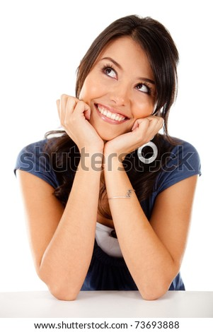 Thoughtful latin woman looking up - isolated over white - stock photo