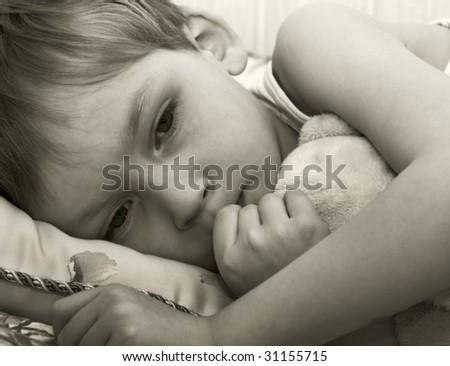 Thoughtful little boy - stock photo