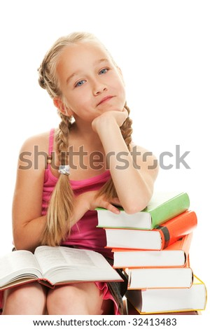 Thoughtful little schoolgirl sitting on a stack of books - stock photo
