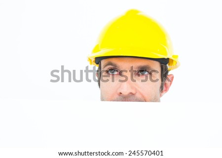 Thoughtful male architect with bill board over white background