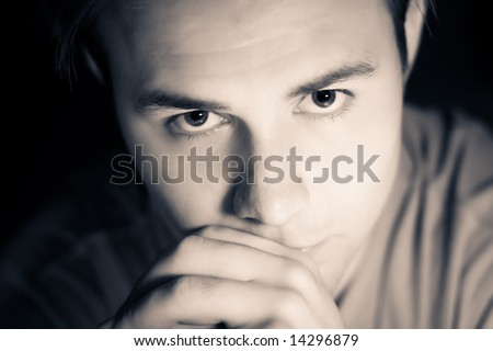Thoughtful male portrait. Soft yellow and blue tint, small dof. - stock photo