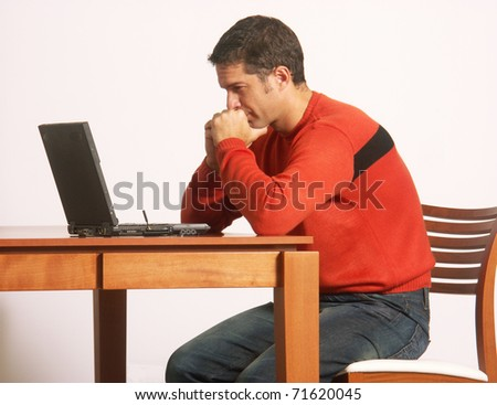 thoughtful man in a computer. - stock photo