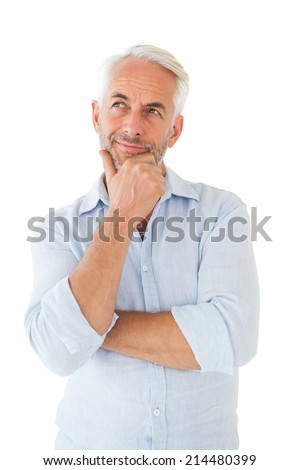 Thoughtful man posing with hand on chin on white background - stock photo
