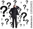 Thoughtful man surrounded by question marks - stock photo