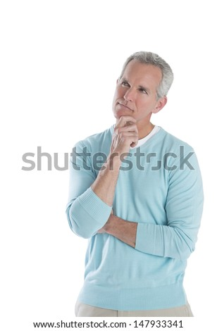 Thoughtful mature man with hand on chin looking away against white background - stock photo