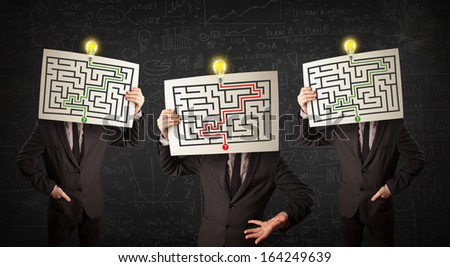 Thoughtful men in formal gesturing with labyrinth on cardboard in front of their head - stock photo