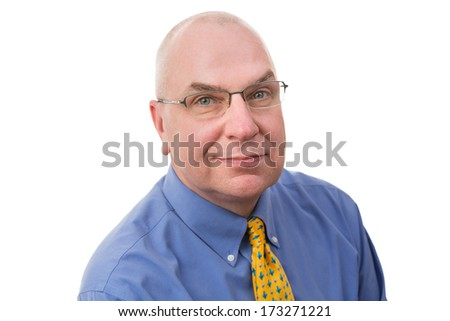 Thoughtful middle-aged businessman wearing glasses looking at the camera with a pensive analytical expression, head and shoulders portrait on white - stock photo
