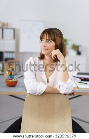 Thoughtful Office Woman Leaning on the Back of Chair at her Table and Looking Up. - stock photo