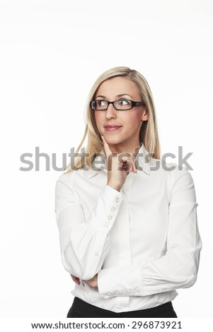 Thoughtful Pretty Young Businesswoman Looking Into the Distance with Hand on her Face. Isolated on White Background.